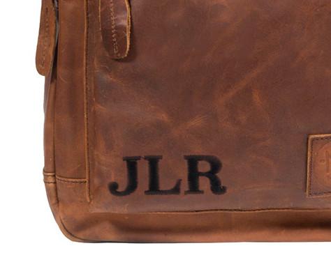 mahi initials on leather bag
