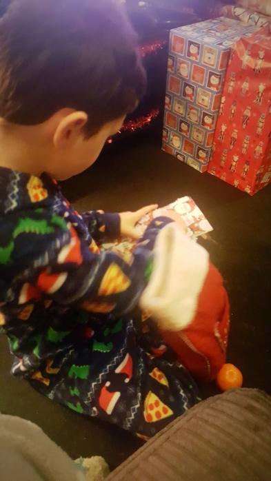 Opening Christmas stocking