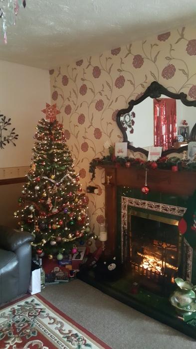 Festive Christmas tree and fireplace